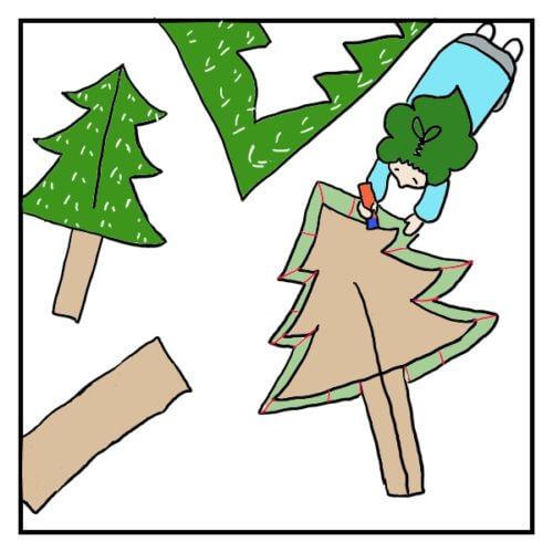 ダンボールでクリスマスツリーを作るため、包装紙を貼っている女性の絵