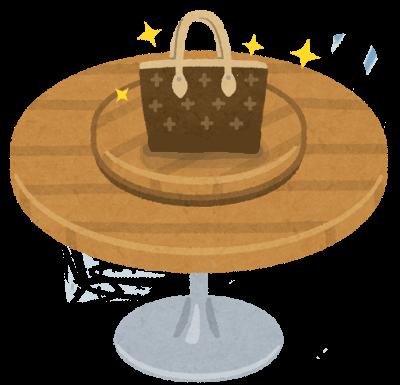 レストランのテーブルの上にブランドバッグが置いてある絵